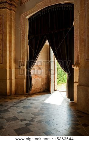 Vintage empty interior with curtains and tiles floor
