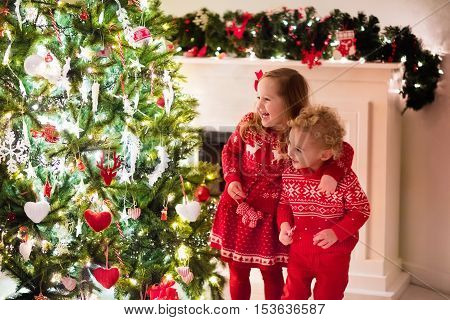 Kids Under Christmas Tree