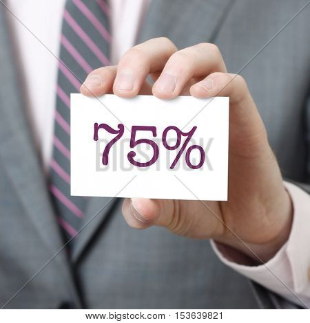 75% written on a card held by a businessman