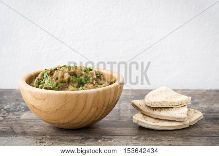 Baba ganoush in wooden bowl on wooden table