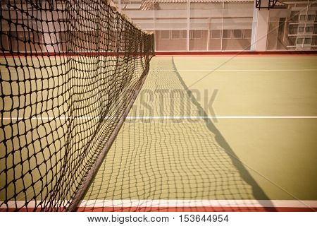 Tennis net and court at terrace hotel