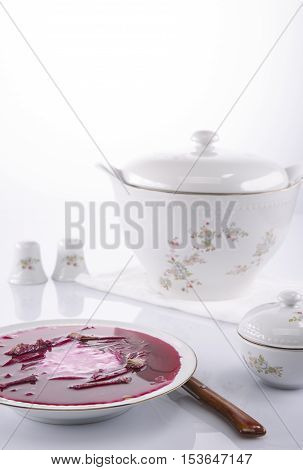 Russian borscht in a white plate and a tureen