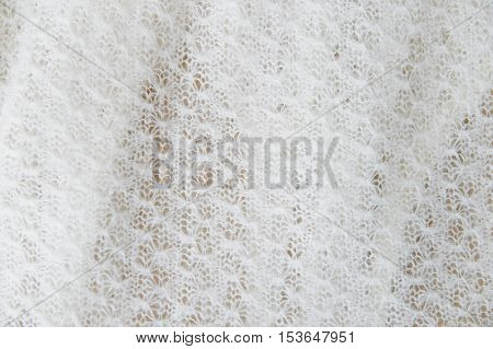 white delicate texture of knitted fabric cashmere, wool. Close