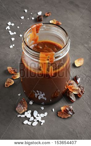 Homemade Salted Caramel In Glass Jar And Caramelized Sugar