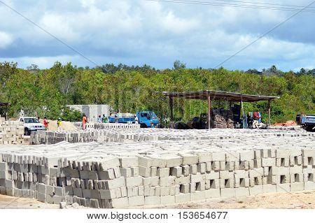 Cinder block factory dry in the sun in a village in Zanzibar