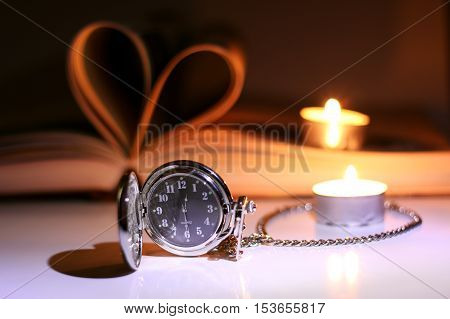 book made up in shape of heart and pocket retro watches candles