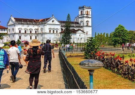 Old Goa India - November 13 2012: Unidentified tourists visit to the famous landmark - Church of St. Francis of Assisi - Roman Catholic church.