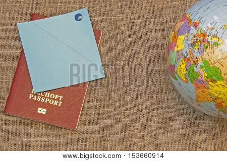 festive sticker on canvas canvas of gray brown linen,passport and the globe