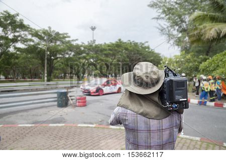 Video cameraman operator Racing car in a racetrack.