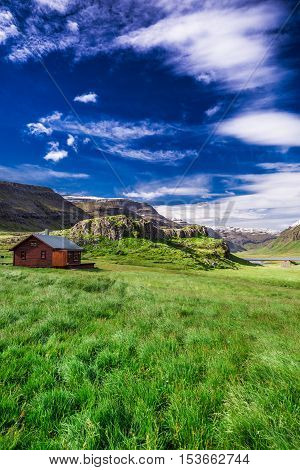 Small cottage in the mountains Iceland in summer