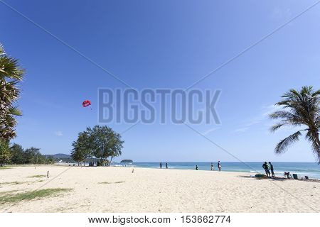 Parasailing extreme sports on karon beach phuket thailand in blue sky and beautiful beach scenery background