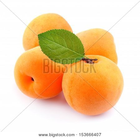 Apricots with leafs isolated on white .