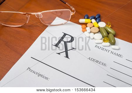 rx medical blank with pills and glasses on table