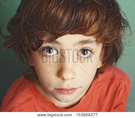 preteen handsome boy expressive close up serious portrait with big eyes
