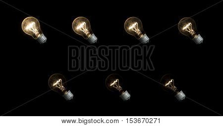Seven Lightbulbs On Black Background