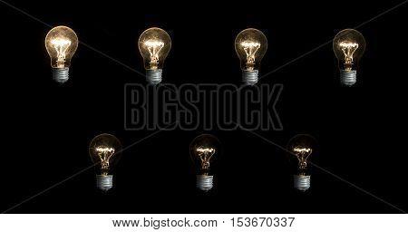 Seven Lightbulbs On Black Background