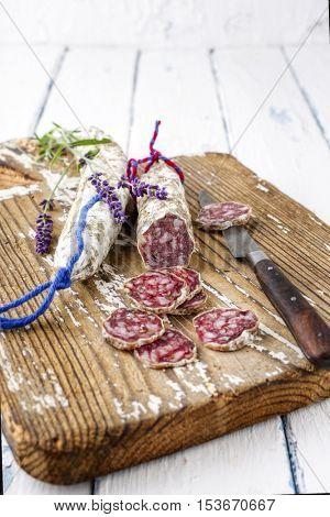 Salami sliced on Cutting Board