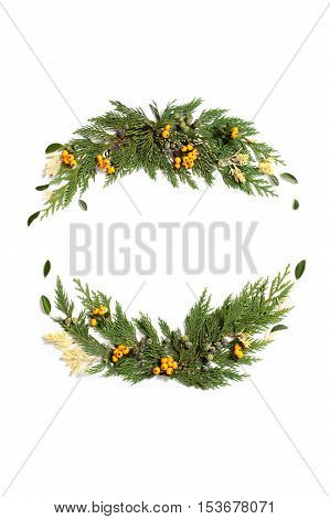 Christmas concept - frame wreath with evergreen Cupressus nootkatensis and Pyracantha red and yellow berries. Flat lay top view. poster