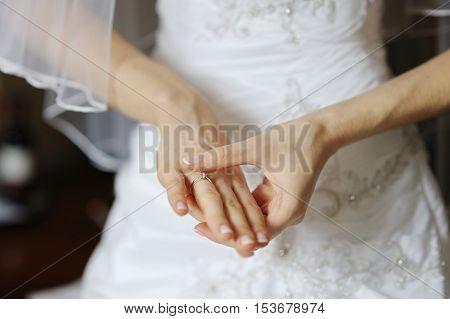 Bride's Hands And A Wedding Or Angagement Ring