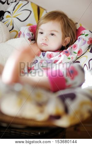 Little Sad Girl In Pajamas On Sunny Morning