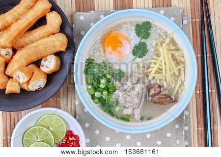 Rice porridge with mined pork and chicken lever with Patongko (deep-fried dough stick)