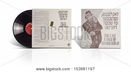 Rishon LeZion Israel-August 4 2016: Old used vinyl album The last laugh of Shimon Dzigan. Manufactured by Gal-Ron in Israel in 1970 under Label Galton L-6006. All titles are printed in English & Yiddish. Covers and vinyl disc are taken on white background