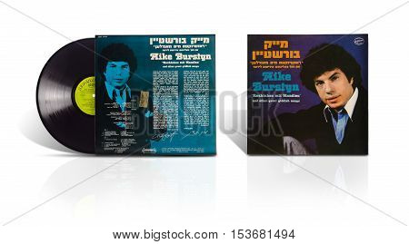 Rishon LeZion Israel-August 4 2016: Old used vinyl album Mike Burstyn Rozhinkes mit Mandlen and other great Yiddish songs. under label Hed-Arzi ‎Ltd - BAN 14784 The Israel Records Manufacturing Co.Ramat-Gan Israel in 1979