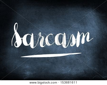 Sarcasm handwritten on a chalkboard
