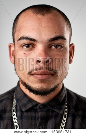 Portrait of real hispanic man with no expression ID or passport photo full collection of diverse face and expressions
