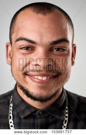 Happy smiling latino man portrait of real person in studio. full collection of diverse faces in this set.