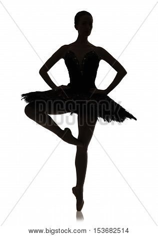 A silhouette of ballerina making ballet position pirouette against white background, isolated. Professional dancer in tutu skirt. Choreography classes concept