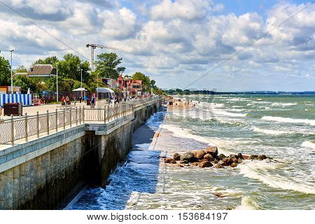 Zelenograd Russia - July 16 2016: View to the Baltic Sea and seafront promenade of Zelenograd. Curonian spit Kaliningrad region. Russia