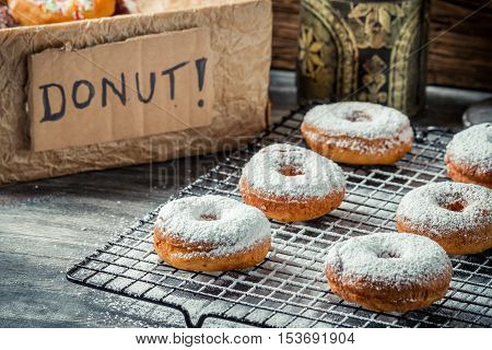 Fresh Donuts With Powder Sugar On Cooling Rack
