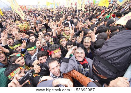 DIYARBAKIR,TURKEY - MARCH 21, 2013: Kurds celebrating their traditional feast Newroz that means 'new day' in kurdish on March 21, 2013 in Diyarbakir, Turkey.