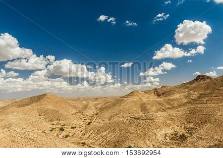 Mountain views in the desert. Tourists on top of a hill. Tunisia, Africa.