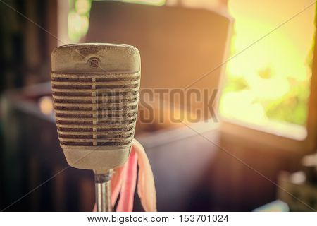 Vintage rustic Microphone with vintage flair background.