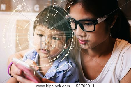 mom teaching Hi tech kid to use technology device. Asian baby looking at hi technology smart phone with coding eye. Mother teaching Smart asian child about technology communication device.