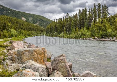 Granite Boulders Lining A Mountain River - Alberta, Canada