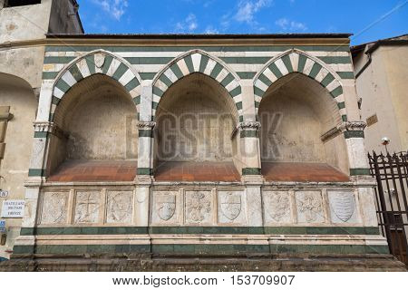FLORENCE, ITALY - SEPTEMBER 2016 : Holy Cross (Basilica di Santa Croce) external wall, Franciscan church in Florence, Italy on September 21, 2016. Known as temple of Italian Glories
