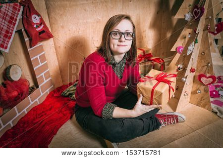 Girl Holding Presents A Pile Of Wrapped Christmas Gifts