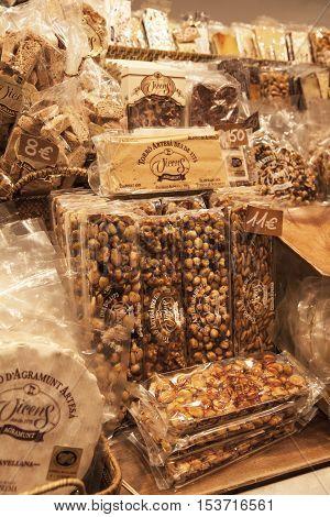 BARCELONA, SPAIN - OCTOBER 16, 2016: spanisch sweets: different turron, polvorones, mantecados, nougat in La Boqueria market. La Boqueria market -is a large public market and popular tourist landmark in Barcelona