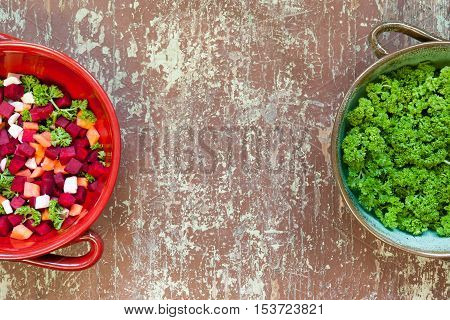 Top view of vegetable soup ingredients in a clay bowl