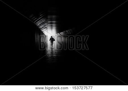 Man goes to the light at the end of the tunnel