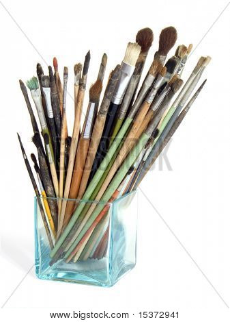 Artist's brushes in the glass isolated on white poster