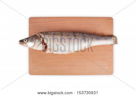 Fresh pike on a wooden chopping board. Fillet of pike isolated on white background