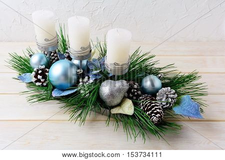 Christmas background with blue ornaments decorated candleholder. Christmas holidays decoration with blue ornaments. Christmas greeting background.