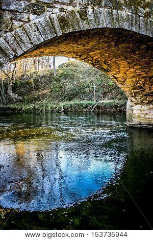 Antietam Creek flowing through stone arch of Burnside's Bridge