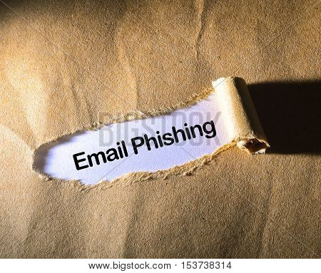 Email Phishing on the brown torn paper