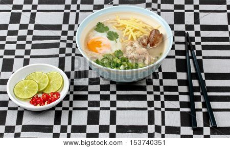 Home made,Rice porridge with mined pork and chicken lever served with spicy sour fillin is poppular food set of Asia .