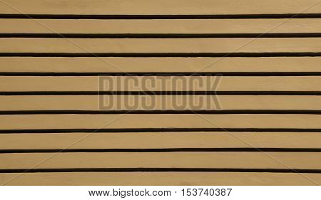 Brown wood siding forms a regular pattern that can be used for backgrounds.